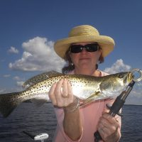 "Pat Shannon of Lakeland shows off her 20"" speckled Sea trout that was caught in Crystal River."