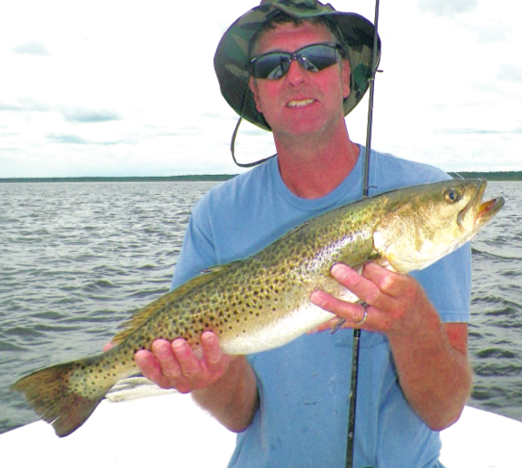"""Jeff Moore of Macon , Ga. with a 25"""" trout 6/1/14."""