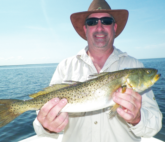 """Mike Jones of Charleston , South Carolina with a 24+"""" trout."""