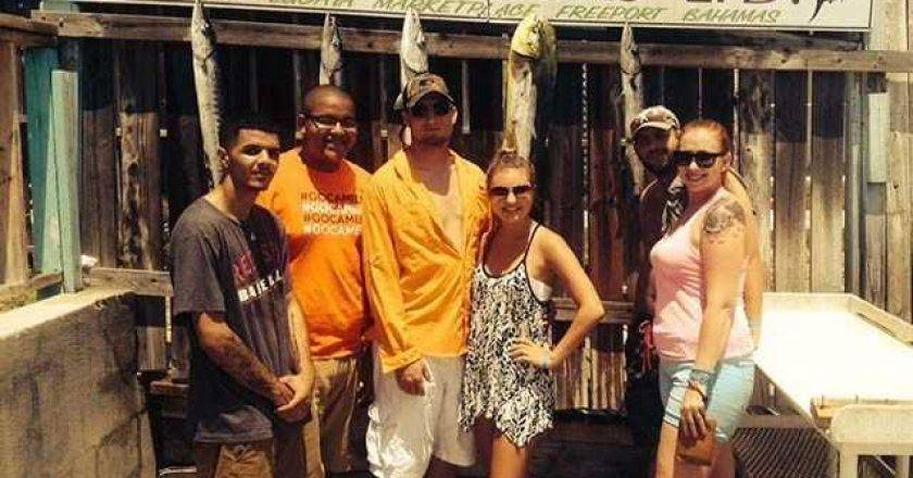 Happy Reef Tour customers with a variety of deep sea catches.