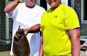 Richard Wilcox and son with a nice flounder.