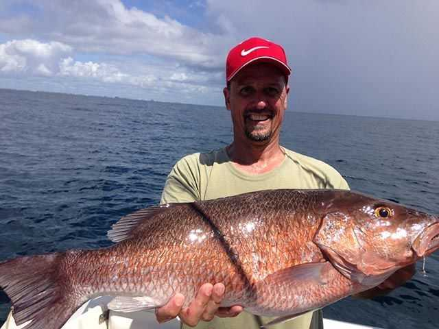 Jeff Gray with a nice Cubera snapper caught aboard A Beautiful Day on live greenie at Donaldson Reef. Photo credit: Tyler Herath.