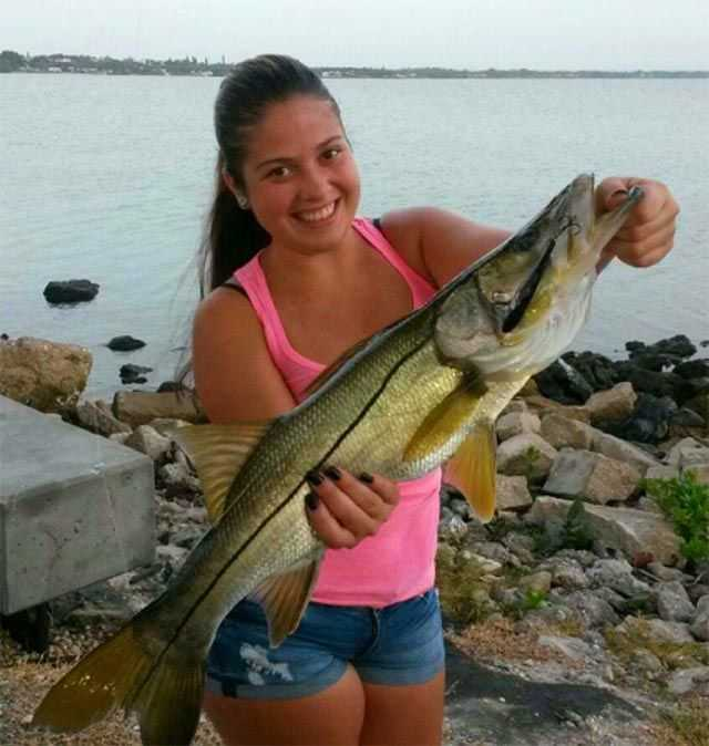 Gabby Collazo caught this beautiful snook using an Unfair Lures Mullet at the Jensen Beach Causeway, her personal best snook, 31-inches.