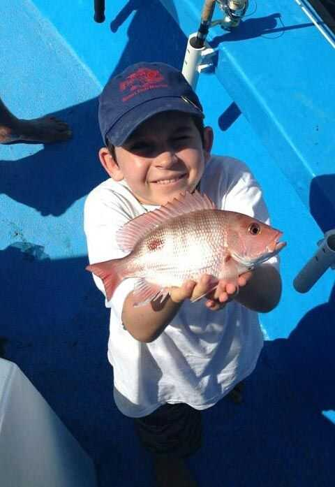 Leon Harwood catches his first Red Snapper during the July mini season aboard the Safari 1. PHOTO CREDIT: Capt. Rocky Carbia.