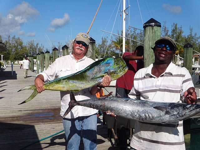 """Wilbur Baird and Captain Breon Whylly with just some of the fish they caught during a strong bite while fishing """"The Bridge"""" in southern Eleuthera. PHOTO CREDIT: Kathryn Baird."""