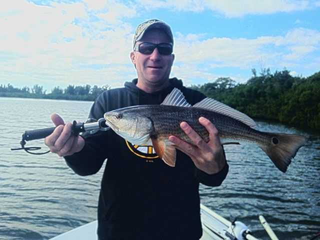 Ray Bergeron with a sight fished red. PHOTO CREDIT: Capt. Gus Brugger.