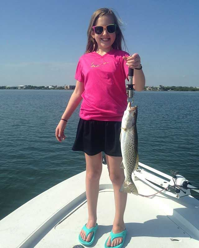 Junior angler with a nice Indian River Lagoon trout. PHOTO CREDIT: Capt. Gus Brugger.