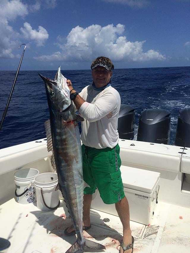"""Peter Maury, Dockmaster at Bay Street Marina, with a 70-pound wahoo caught in the Exuma's on a lure. """"Two we caught were 70-pounds, one was 50-pounds, and three were in the 20- to 30-pound range. PHOTO PROVIDED by Peter Maury."""