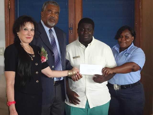 Dafna Ronis, General Manager Bimini Big Game Club Resort & Marina; Mr. Oscar Munroe, Senior Administrator, Bimini and Cat Cay; Jaquan Brennan; and Marci Ellis (Jaquan's mother).