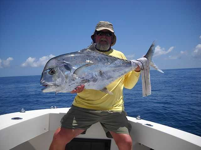 Mike Johnson holds one of two 31 pound African Pompano caught in 52 feet of water eight miles east of the Ft. Pierce inlet while fishing with Capt. Steve Tate. Both fish were caught on live greenies. PHOTO CREDIT: Capt. Steve Tate.