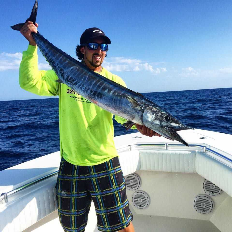 Mike Cram with a wahoo caught offshore Sebastian. On the same day, Mike pulled in a kingfish, a couple of dolphin and a 48.8-pound gag grouper. PHOTO CREDIT: Heather Blake.