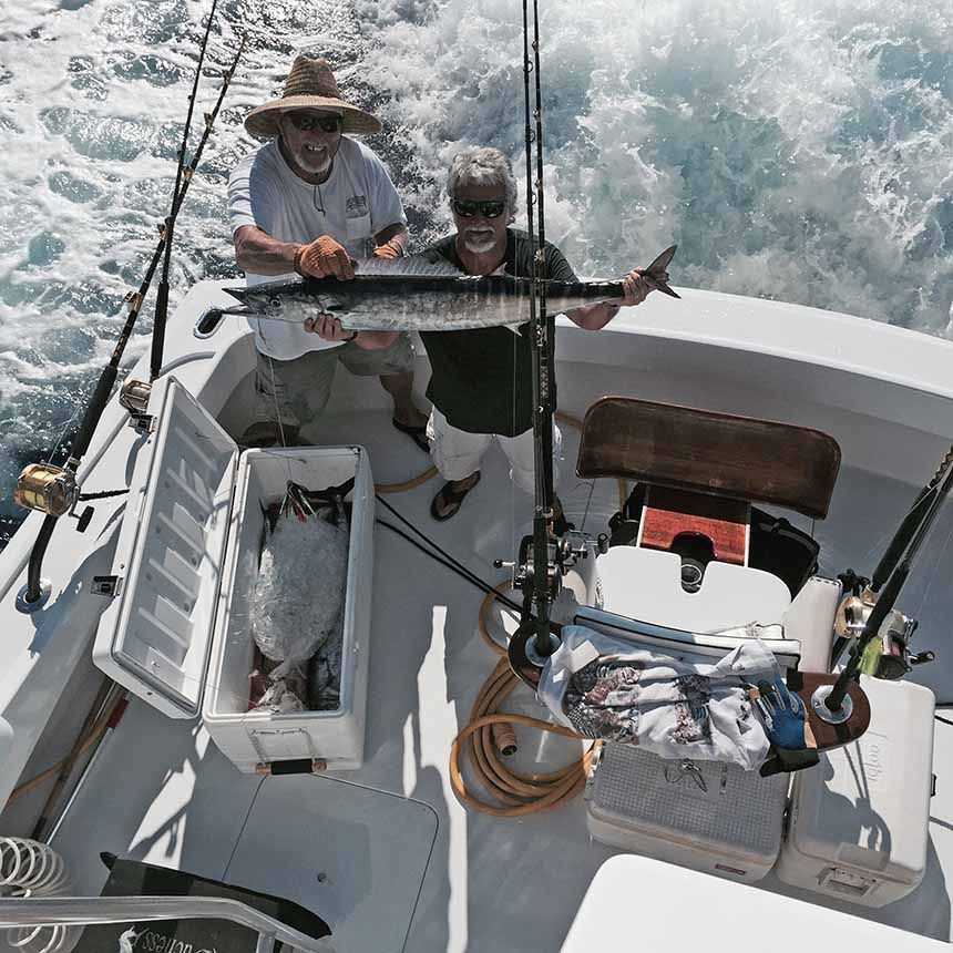 Capt. Billy Black and Andy Holcombe with a 45-pound wahoo caught aboard Duchess while fishing out of Grand Cay.