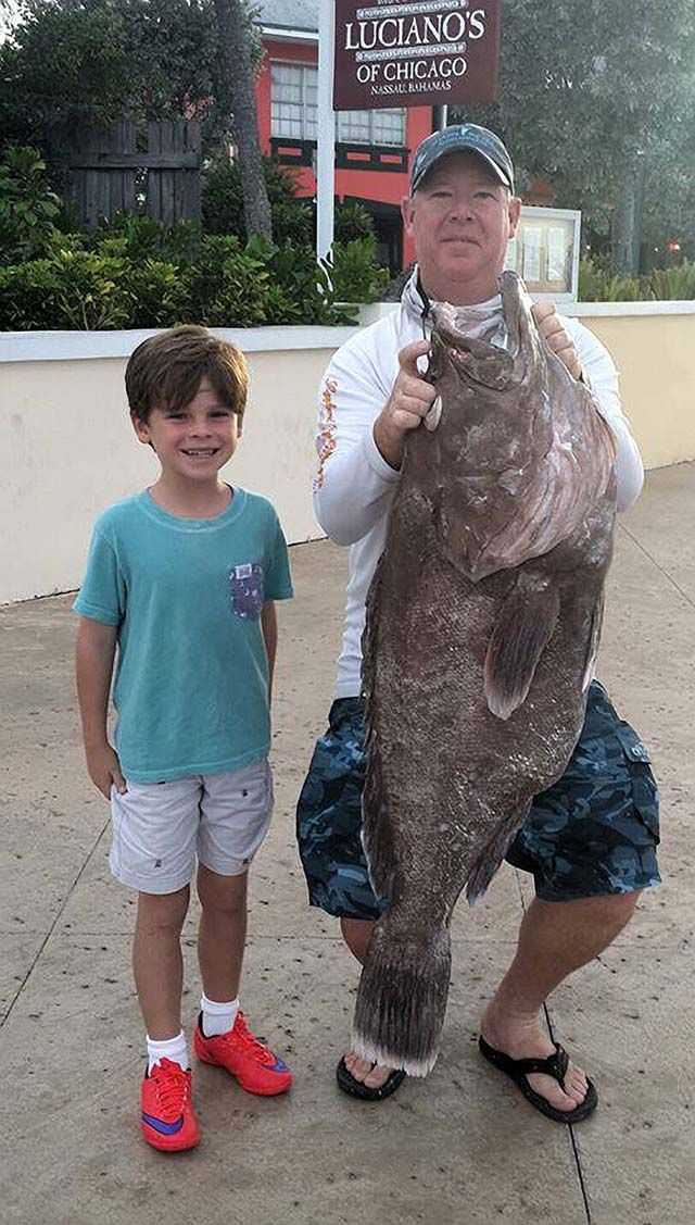 """Jack Boals and Keith Kelty with a 40-pound grouper caught in the Lords of the Deep fishing tournament. The grouper won the """"Largest Grouper"""" awards. Photo courtesy of Harbourside Marine."""