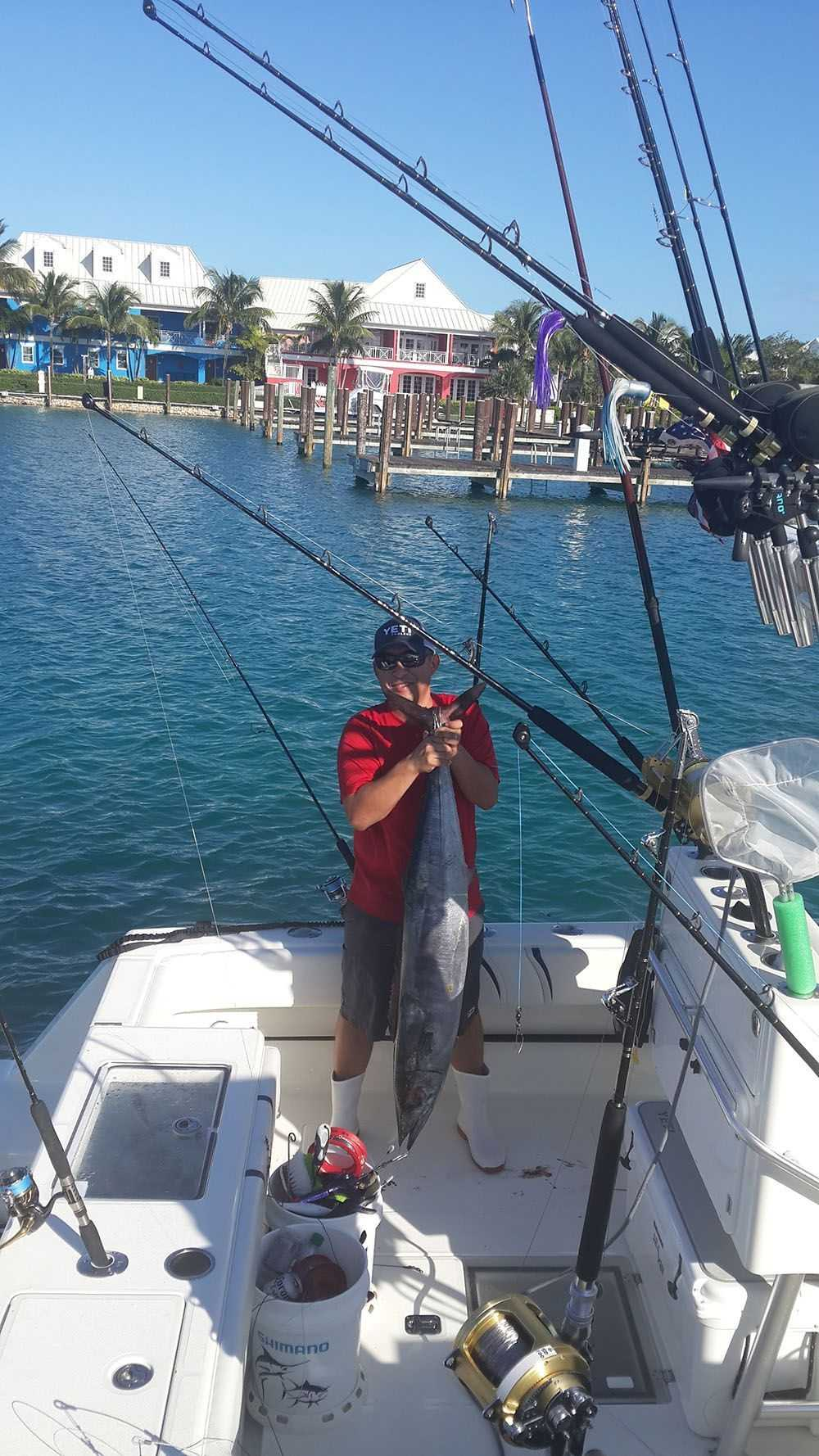 Son Nguyen on the MV Dialed In with a 40-pound wahoo. PHOTO CREDIT: Old Bahama Bay.