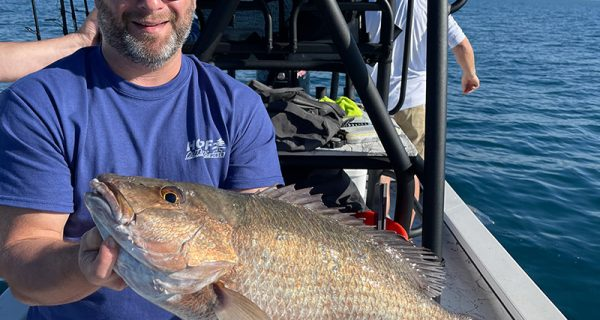 Greg with a big Mangrove snapper.