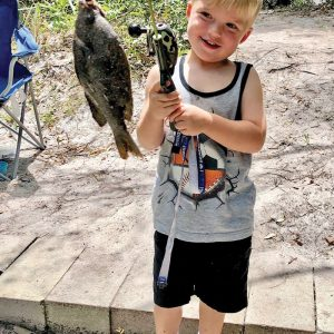 Four-year-old Sawyer Bass caught his first 10-inch sunfish using worms in a canal in Canaveral Groves.
