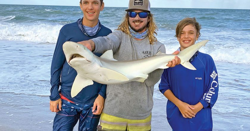 Surf fishing with Capt. Lukas of Cocoa Beach Surf Fishing Chrters, the Brady boys hooked a nice shark!