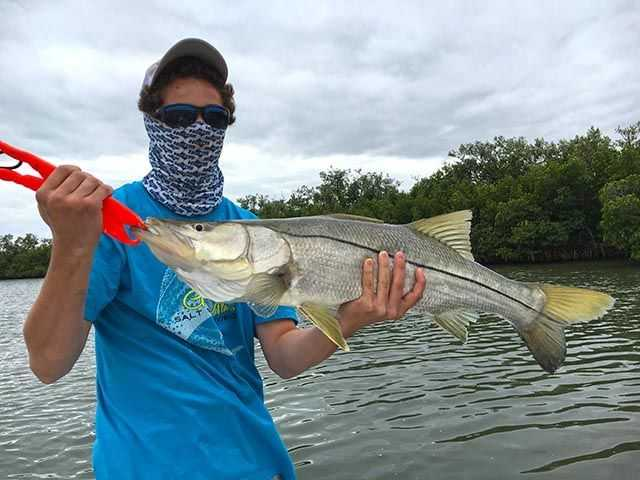 Ethan Wells recently had a banner day fishing with dad, Capt. Pat Wells, and Capt. Charlie. Ethan landed one over slot snook and three redfish, along with some big jacks to make for an exciting morning on the river! PHOTO CREDIT: Capt. Charlie Conner.