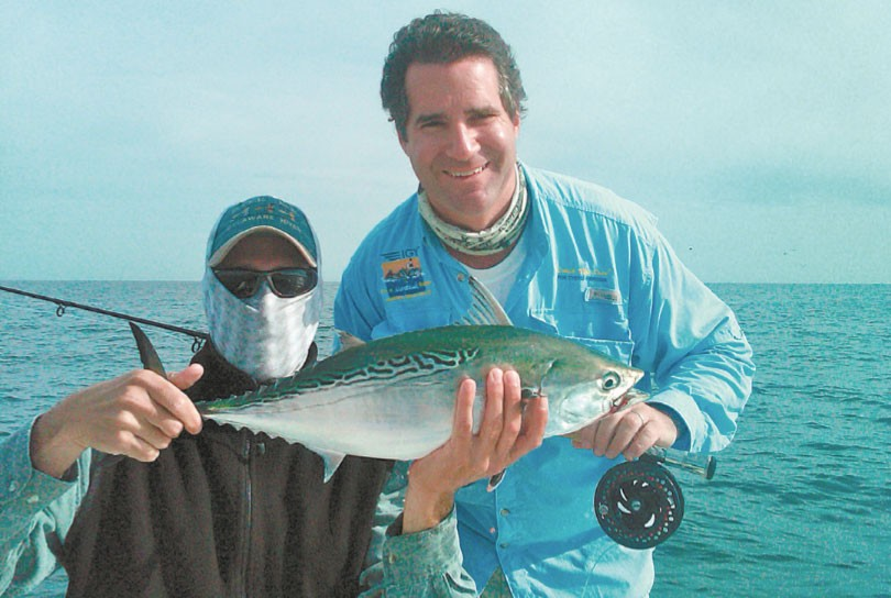 Vinny Catalano of www.longislandflyfishing.com and client Chef Kerry Heernan show off a nice false albacore. Under a sharp summer of fall sun, wearing a bluff to protect your face and neck from the sun is a good idea. Photo courtesy of Capt. Vinny Catalano.
