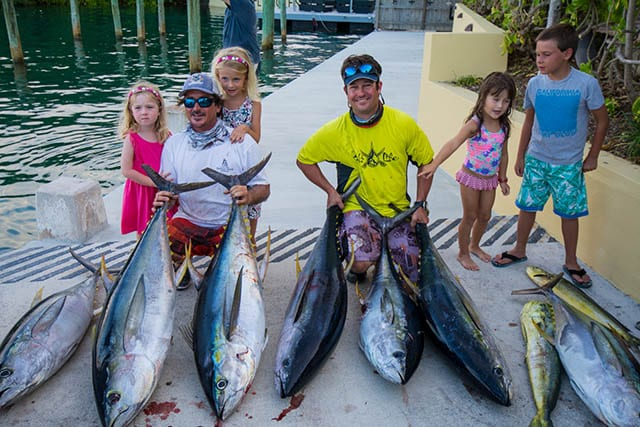 Amelia and Peyton Long with their dad, Aron Long, the captain of Team Long's Marine, and heaviest tuna winner Wayne Russell, with friends Emma Albury and Lucas Waugh. PHOTO CREDIT: Chris Maingot.