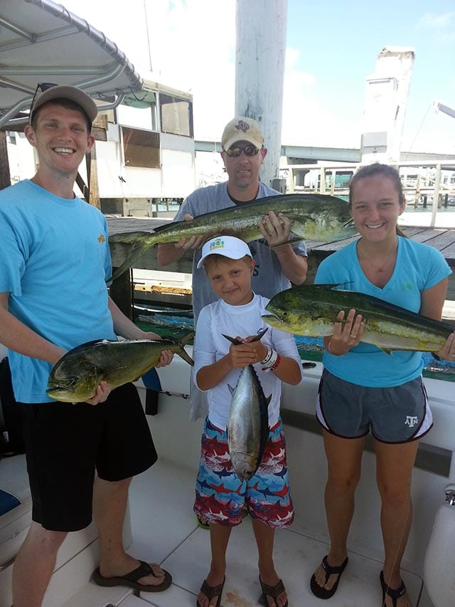 Charter guests from Texas with their day's catch. PHOTO CREDIT: Capt. Teddy Pratt.