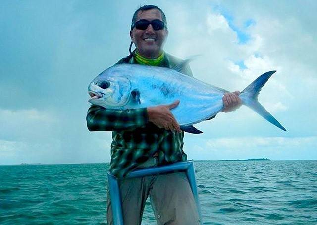 Patricio Lacaruso first time fishing in salt water with one of the two permit he caught on the fly while fishing the flats of Eastern Grand Bahama. PHOTO CREDIT: Firefly Bonefishing.