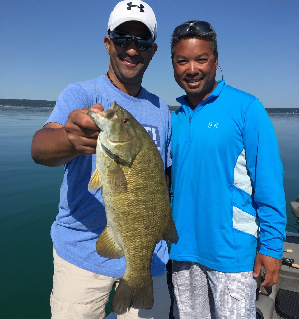 Grand traverse bay fishing report september 2016 for Grand haven fishing report