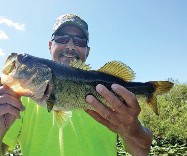 Chino, U.S.M.C., with a Florida Everglades largemouth bass.