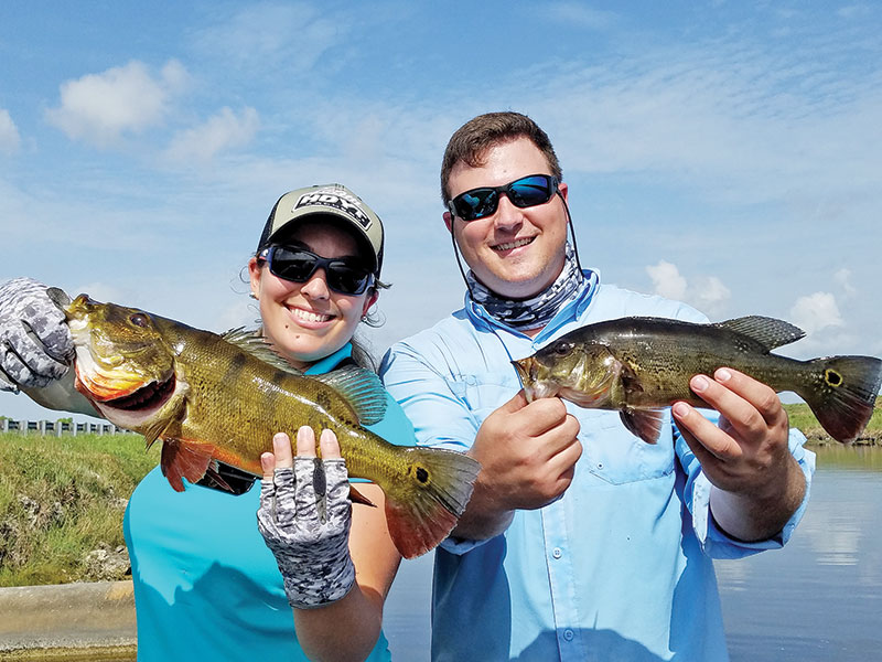 Sadys Mujica and Luke Ford with a double catch of peacock bass.