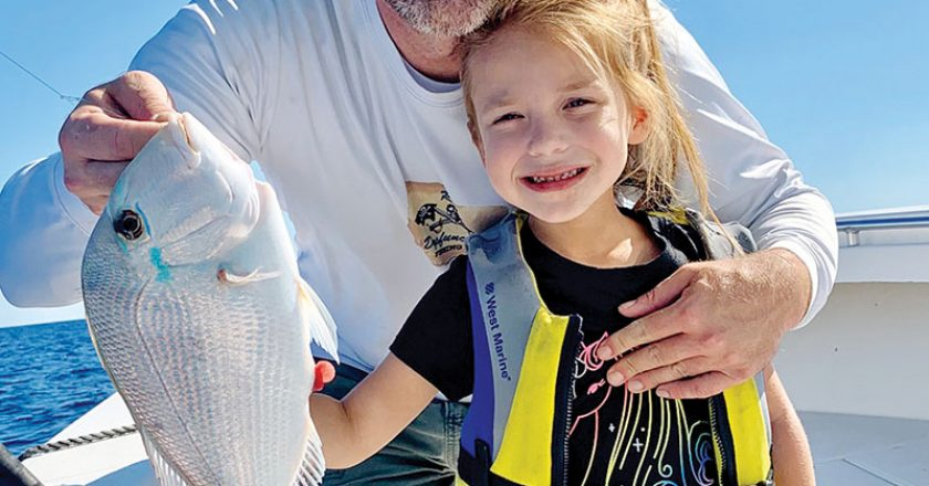 Six year old Brynn Mechler caught a beautiful porgy while fishing with her dad.