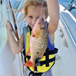 Five-year-old Brooke Mechler caught and released a mutton snapper while fishing with her dad.