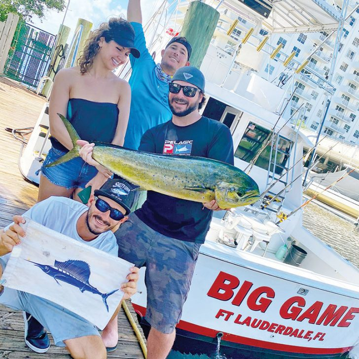 Happy couple with dinner and a sailfish release aboard the Big Game.