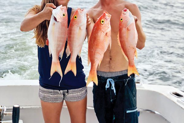 Andrew and Vivian with a nice bunch of snappers caught with New Lattitude Sportfishing.