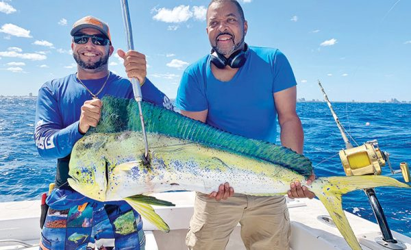 Bobby and angler with a really nice mahi-mahi caught with Fishing Headquarters.