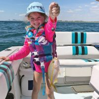 Six-year-old Cambree with her first yellowtail snapper.