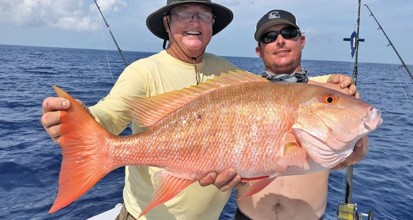 Capt. Paul and Rod with a big mutton snapper caught with Fishing Headquarters.