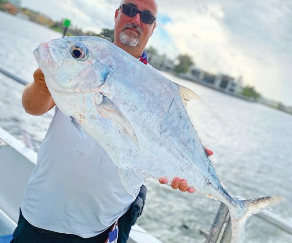 Lucky angler with a tasty African pompano caught aboard the Catch My Drift.