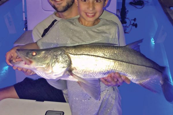 Capt. Ryan put this young angler on his first snook.