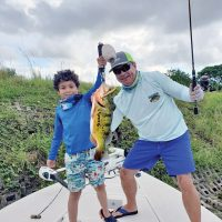 Seven year old Ian Paguaga scored a nice peacock while fishing with his Uncle Bob.