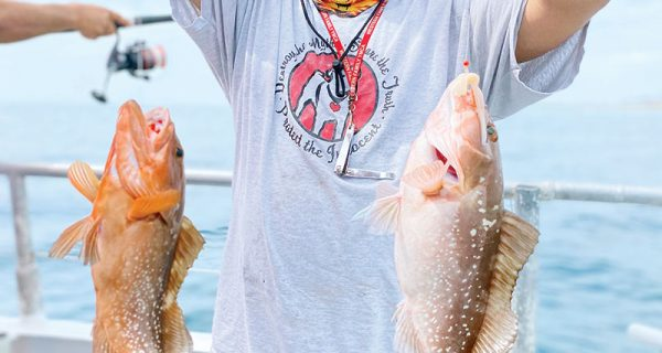 Two for one red grouper caught recently aboard the Catch My Drift.