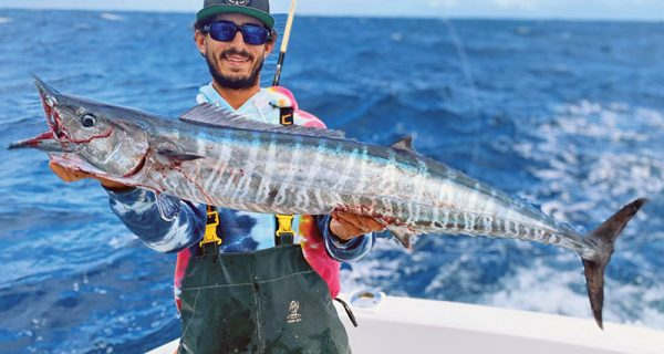 Capt. Nick Colosi with a nice wahoo caught aboard the New Lattitude.