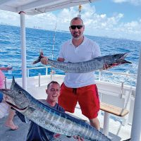 Double header wahoo caught aboard the Catch My Drift.