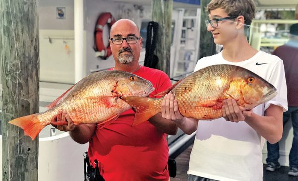 A pair of nice mutton snappers caught aboard the Catch My Drift.