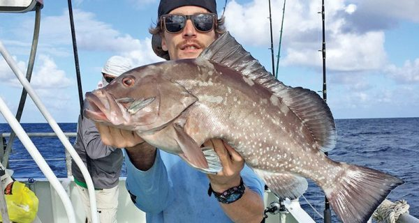 Kyle with a nice red grouper caught drift fishing aboard the 'Catch My Drift.'