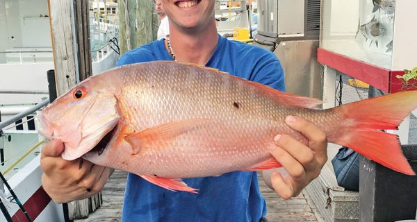 Matt with a nice mutton snapper just caught aboard the Catch My Drift.