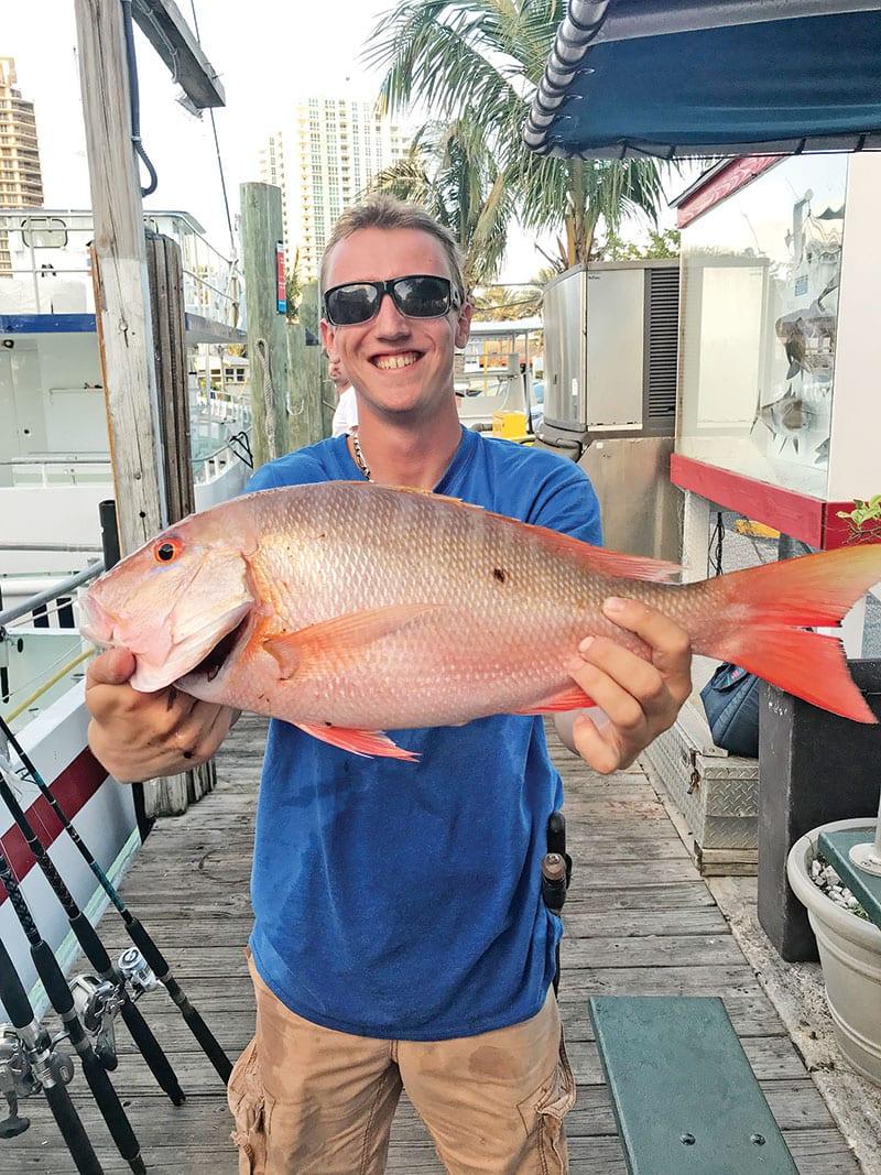 Matt with a nice mutton snapper just caught aboard the Catch My Drift.