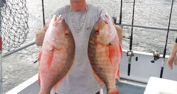 Matt with a pair of nice mutton snapper caught on the Catch My Drift.