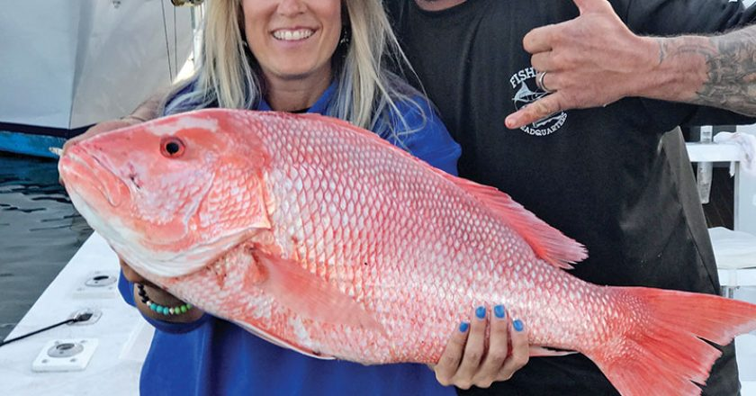 Mick and Michelle with a giant Red Snapper caught with Fishing Headquarters.