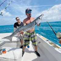 Mick with a big barracuda caught with New Lattitude Sportfishing.