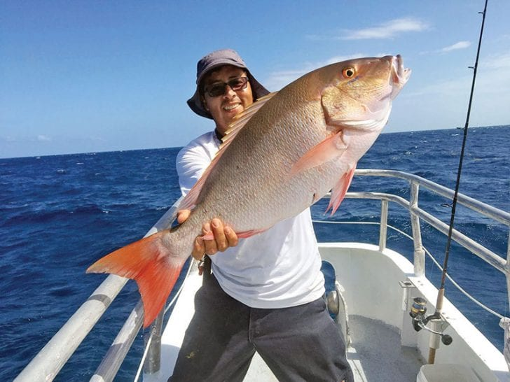 Orlando with a monster mutton snapper caught aboard the Catch My Drift.